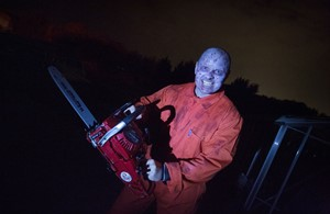 Man with chainsaw